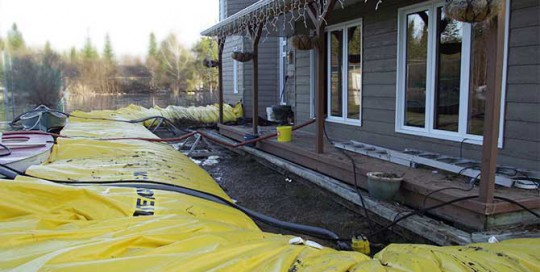 house protected from flooding with the water-gate barriers from megasecureurope